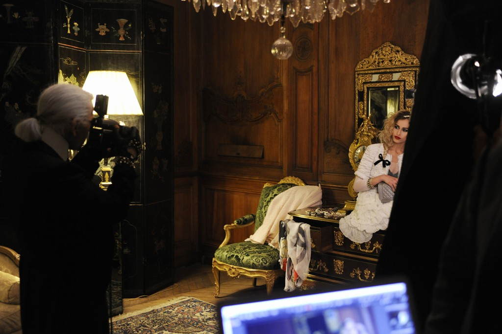 Alice Dellal being photographed by Karl Lagerfeld for Chanel's Boy Chanel handbag advertising campaign.