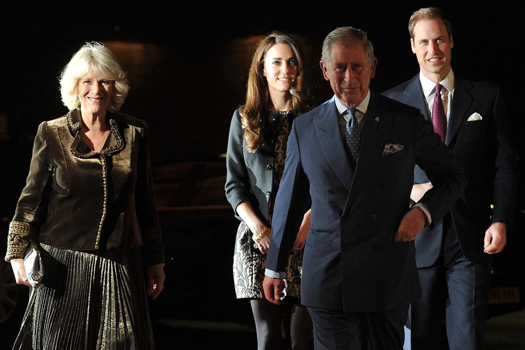The Duchess of Cornwall in Anna Valentine and the Duchess of Cambridge in a Zara dress and Ralph Lauren jacket, with the Prince of Wales and the Duke of Cambridge.