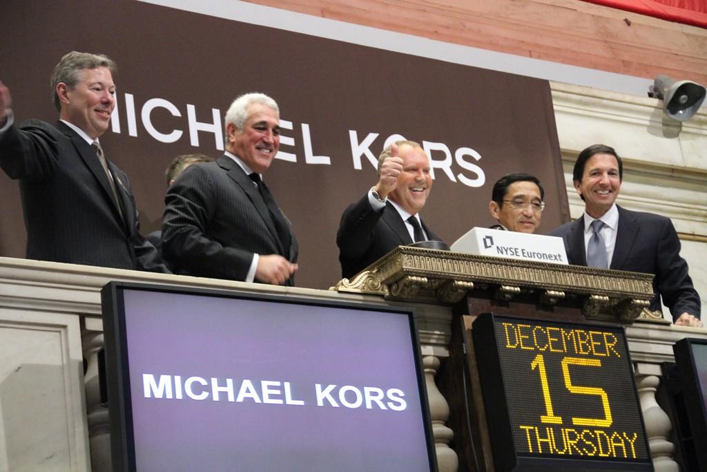 Joseph Parsons, Lawrence Stroll, Michael Kors, Silas Chou, and John Idol ring the opening bell at the New York Stock Exchange Thursday.