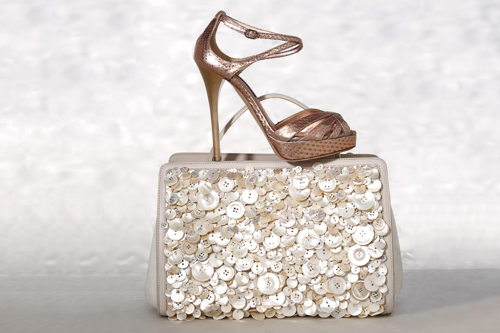 Ralph Lauren Collection's python sandal and The Row's calfskin and mother-of-pearl button bag.