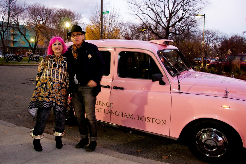 Zandra Rhodes with Alan Bilzerian arriving in Langham's taxi.