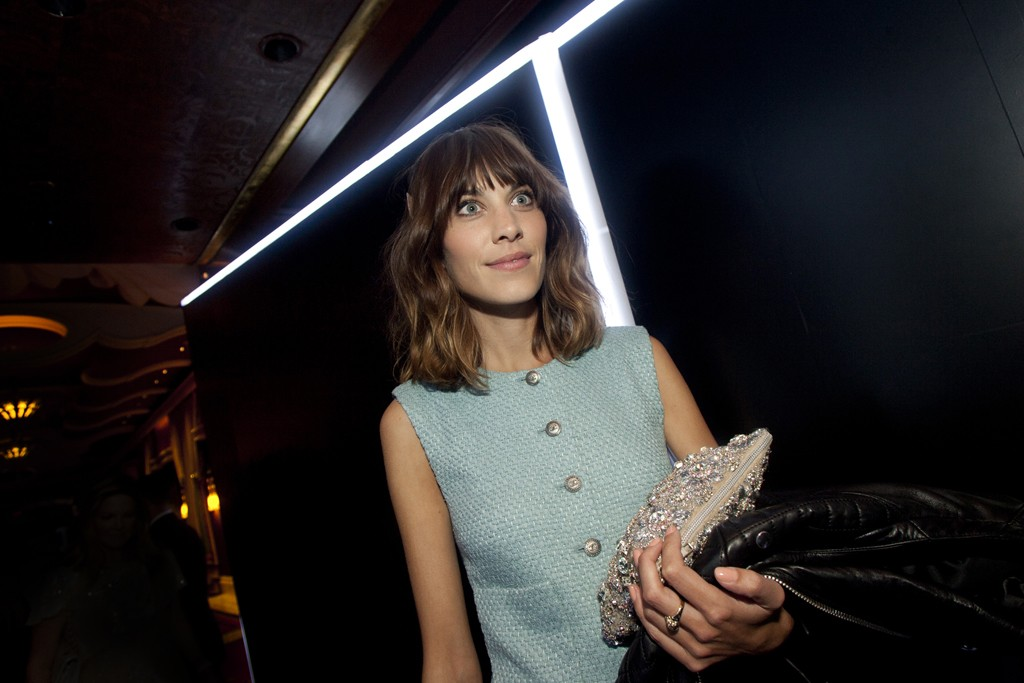 Alexa Chung in a Chanel dress and Christopher Kane clutch.