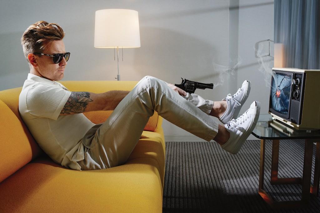 Ewan McGregor in Brioni's silk polo shirt and J Brand's cotton pants. Converse sneakers; Persol Steve McQueen sunglasses.