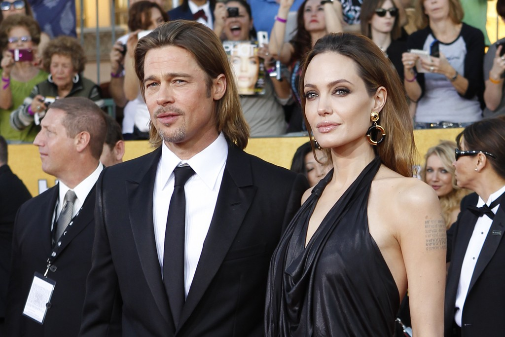 Brad Pitt with Angelina Jolie in Jenny Packham and vintage House of Lavande and Platt Boutique jewelry