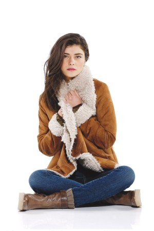 Latte Black's polyester faux shearling jacket with Yummie by Heather Thompson's cotton, polyester and spandex denim jeans.