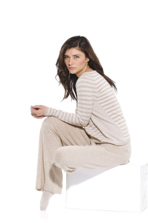 In Cashmere's cashmere sweater and pants.