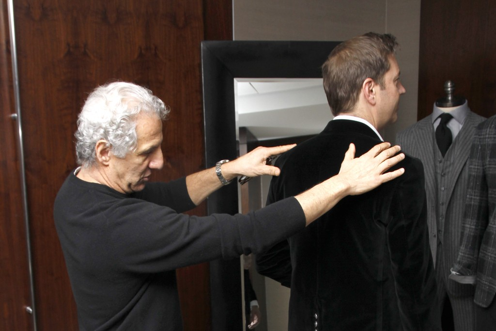 Joseph Abboud helps with the jacket fitting.