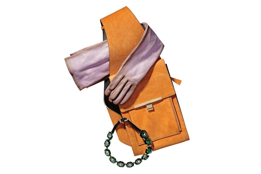 Nina Ricci's lambskin glove. Balenciaga by Nicolas Ghesquière's goat suede and calfskin handbag. Louis Vuitton's resin necklace.
