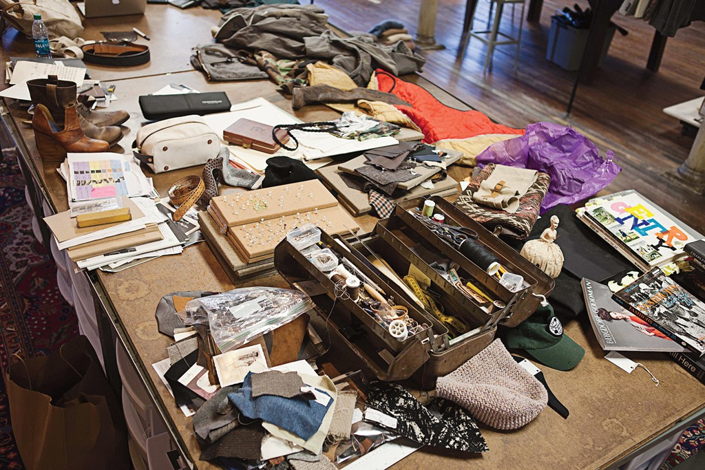 Billy Reid's 12-foot worktable in his Alabama studio is a jumble of family heirlooms, flea-market finds and other mementos that combine to influence his collections.