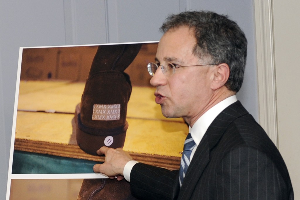 U.S. Attorney Paul J.Fishman points out how counterfeit UGG's boots were smuggled into the country.