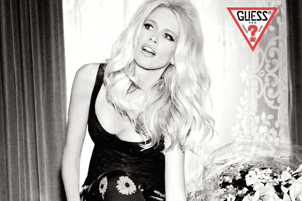 Claudia Schiffer stars in Guess' 30th anniversary ad campaign wearing daisy-print jeans from a new capsule collection
