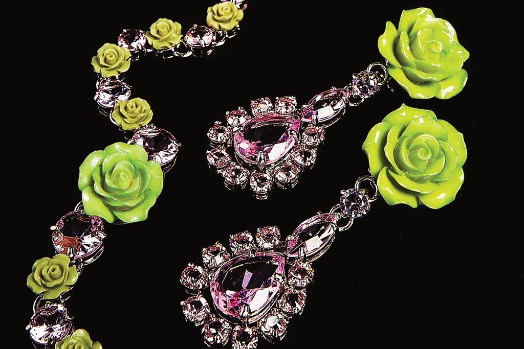 Prada's necklace and earrings with crystal stones and patent leather roses.