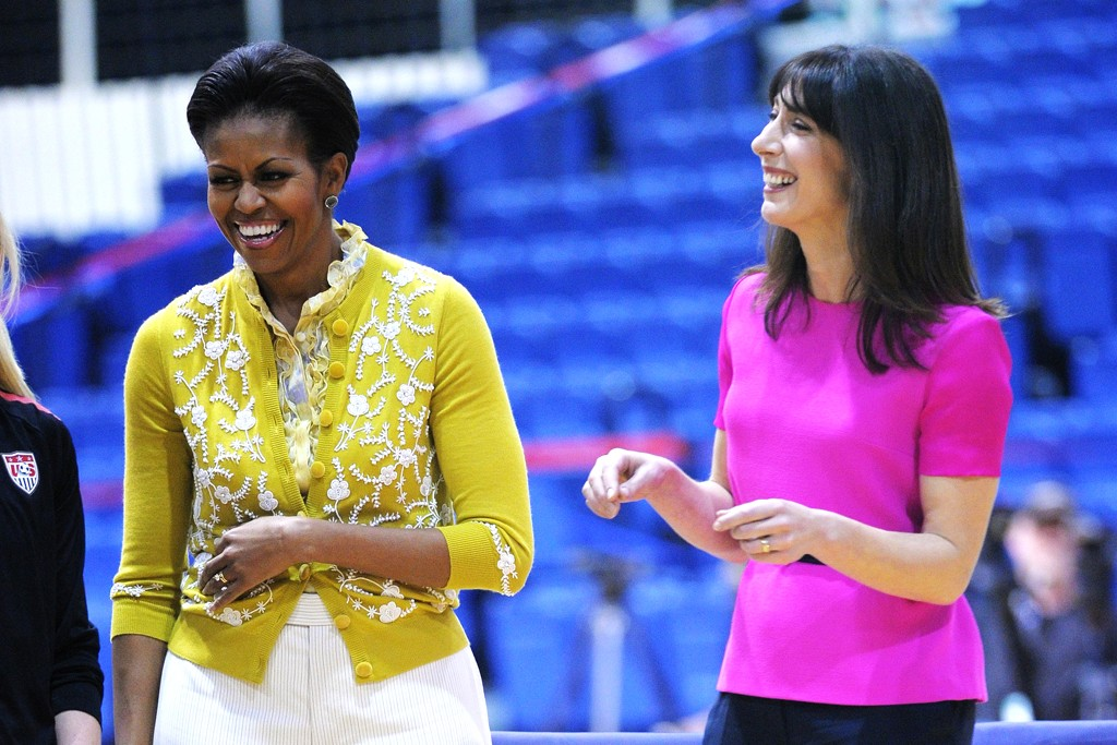 First Ladies Samantha Cameron of Britain and Michelle Obama of the U.S. Cameron sported a bright Roksanda Ilicic top and Obama matched point in her L'Wren Scott sweater.