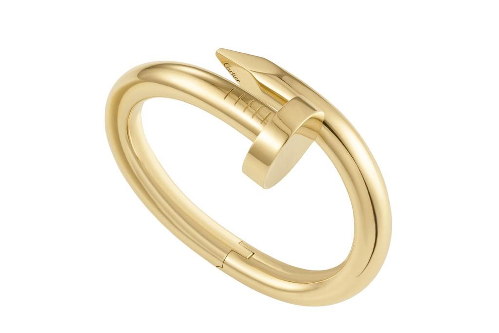 """Cartier's """"Juste un clou"""" yellow gold bracelet."""