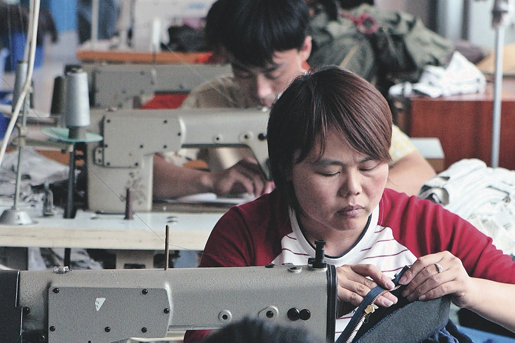 Chinese workers in clothing and textile factory.