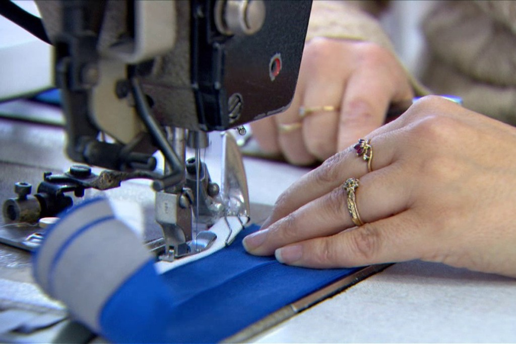 A worker sewing in one of France's apparel factories.