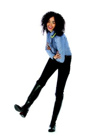 Raleigh Denim's cotton chambray shirt and cotton denim jeans. Tom Binns Design necklace; Ariat boots.