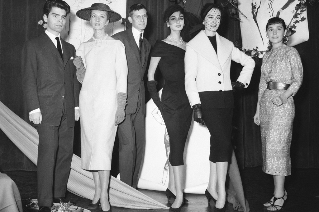 Karl Lagerfeld, Yves Saint Laurent and Colette Bracchi were all winners of the International Woolmark Award in 1954. Here, they pose with models wearing their designs.