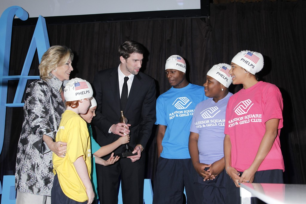 Michael Phelps with kids from the Madison Square Boys & Girls Club, and Donna de Varona.