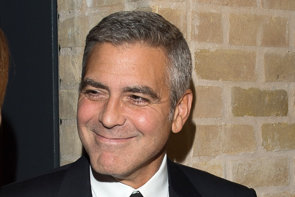George Clooney in Giorgio Armani and Becca Cason Thrash in Givenchy.