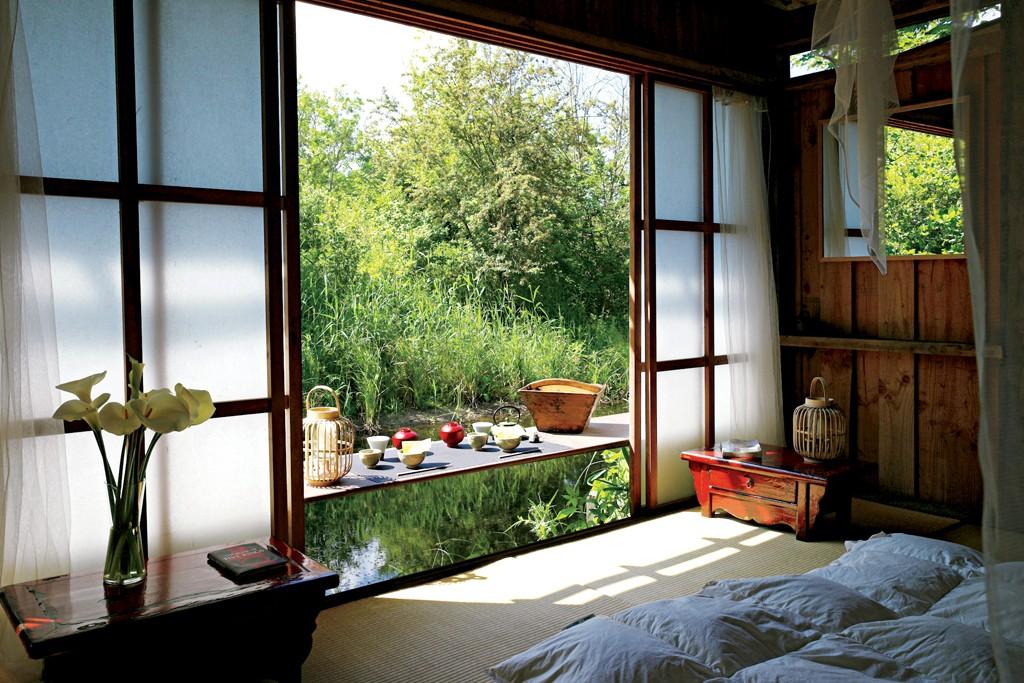A serene guest room at le Bruit de l'Eau in Saint-Quentin-en-Tourmont, France.