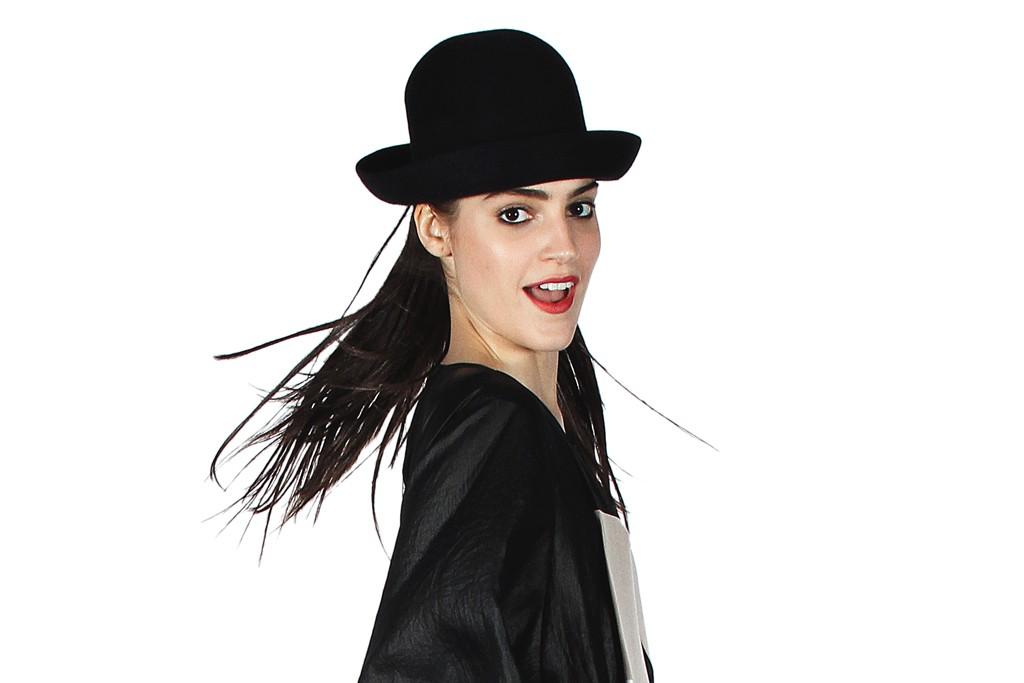 BCBG Max Azria's silk trompe l'oeil jumpsuit and Scha hat.