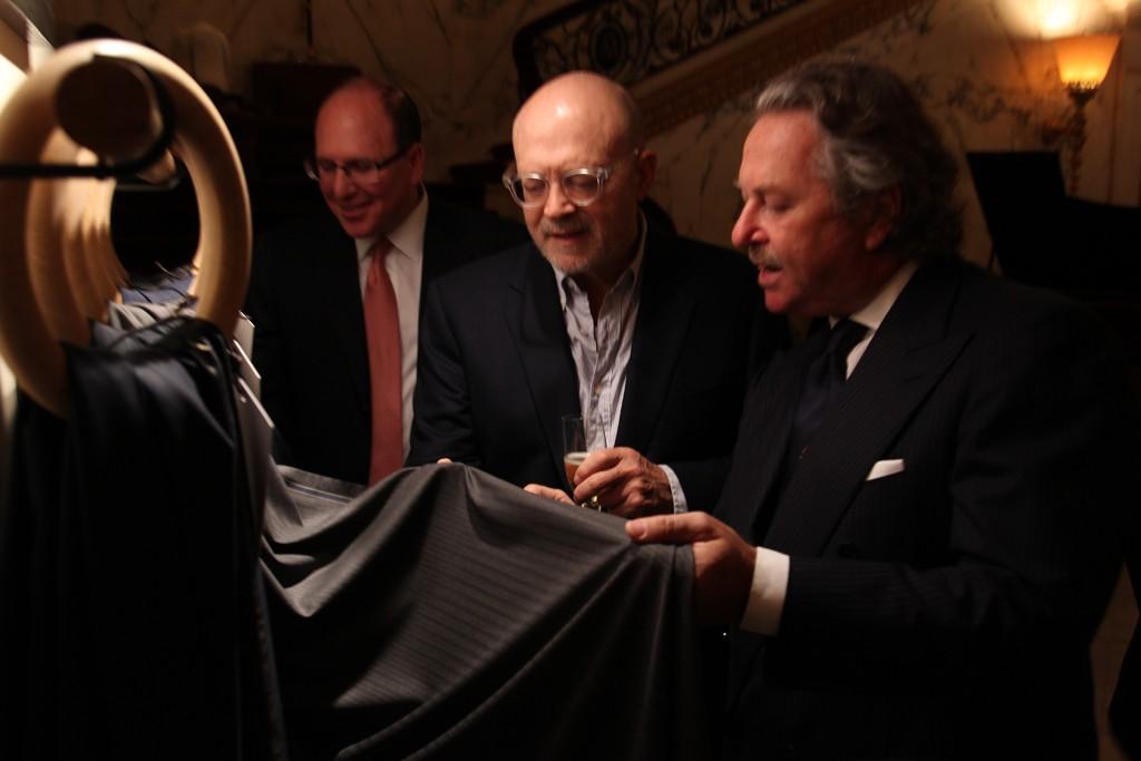 "Millard ""Mickey"" Drexler and Pier Luigi Loro Piana examining the record bale fabrics."