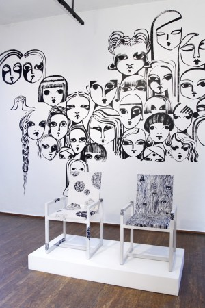 At the Ralph Pucci showroom, chairs and a mural painted by Ruben Toledo.