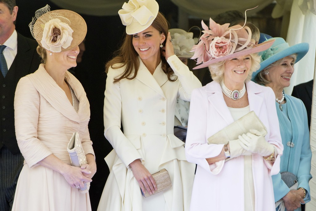 The Countess of Wessex, Duchess of Cambridge and Duchess of Cornwall observe their husbands in the Order of the Garter parade at Windsor Castle.