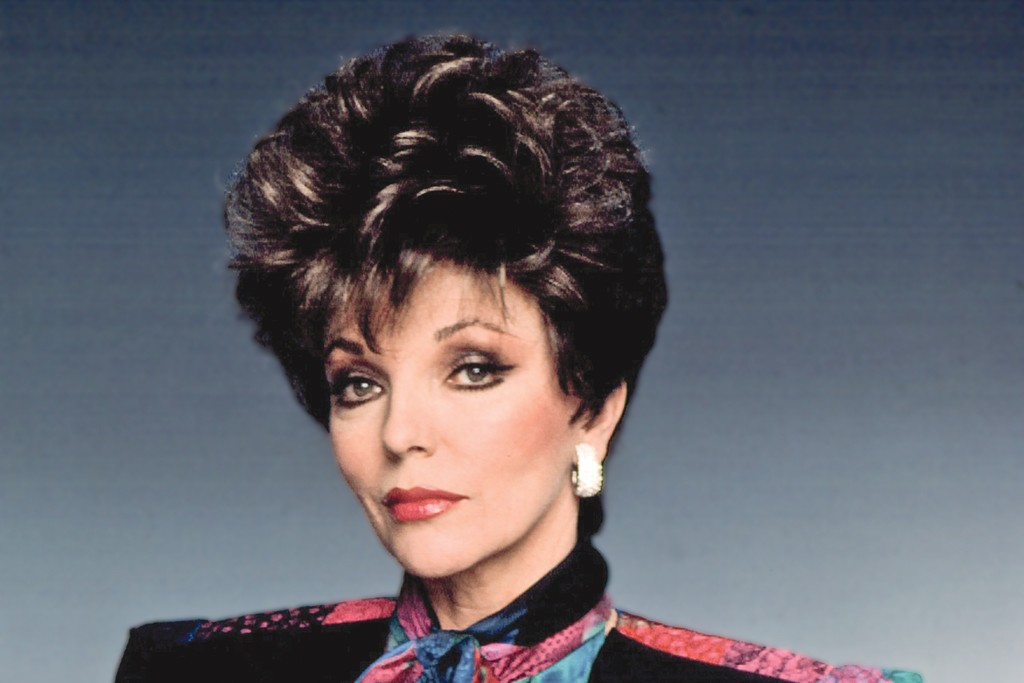 """Joan Collins wearing a quilted fitted jacket as her """"Dynasty"""" character."""