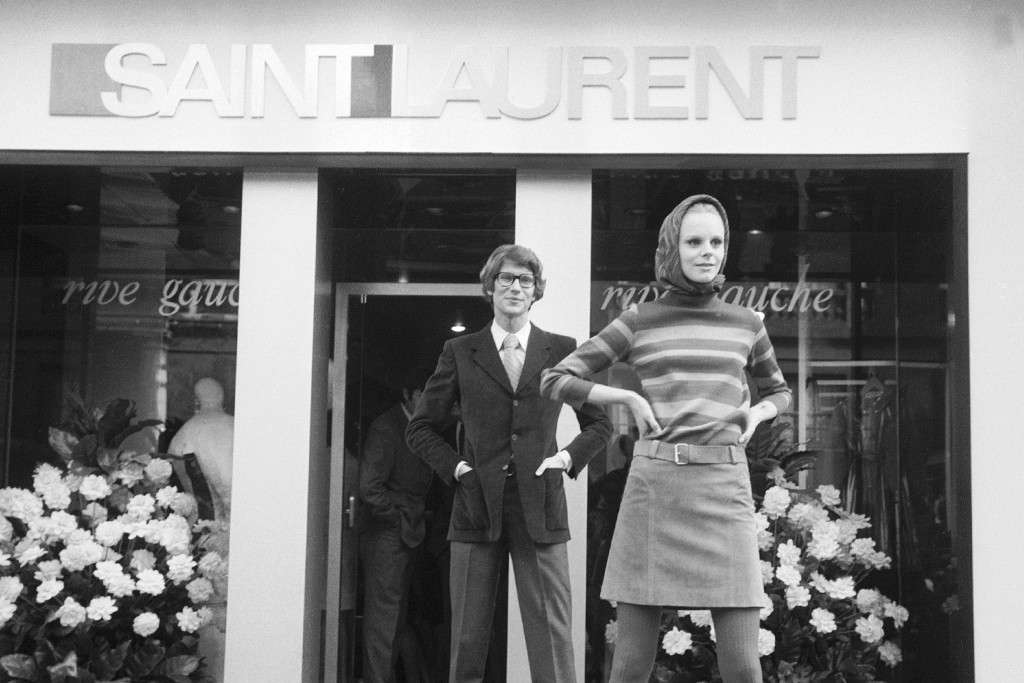 Yves Saint Laurent and a model in front of the first Saint Laurent Rive Gauche boutique in Paris.