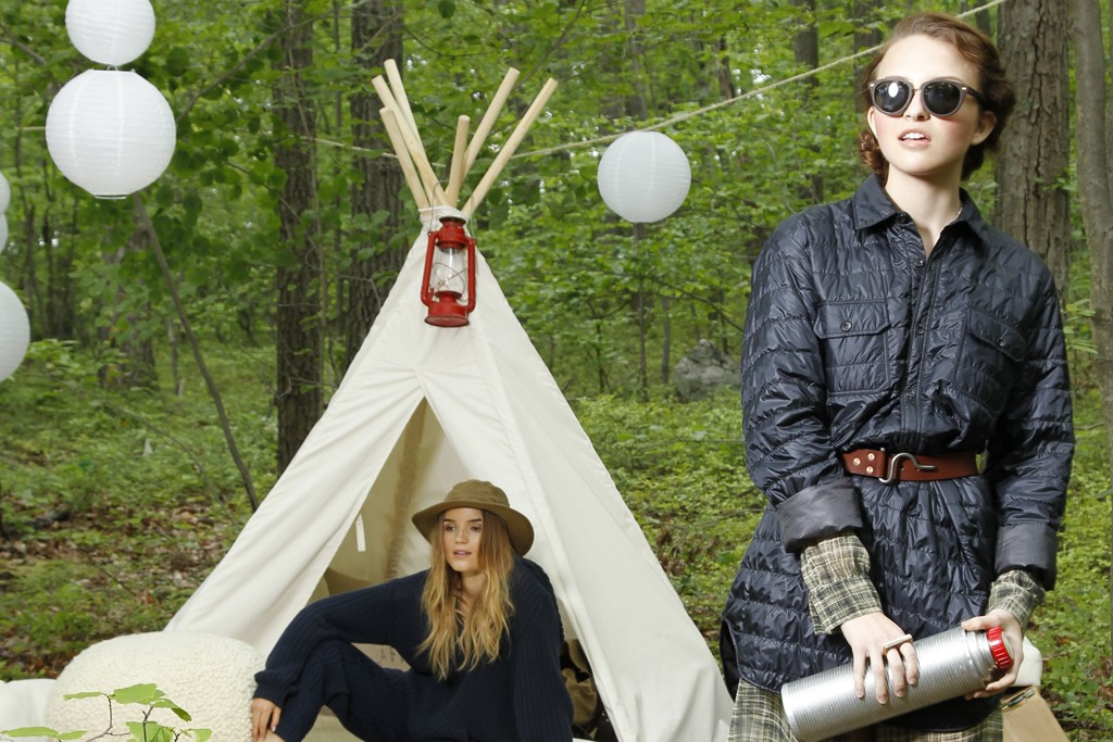 Isaora's down tunic over Diesel's polyester dress. Shwood sunglasses; Blackcreek Mercantile & Trading Co. belt; Sticks & Stones Accessories ring; Sorel boots. FOREGROUND: Lifetime Collective's cotton sweatshirt and acrylic and wool sweatpants. Filson hat; BearPaw slippers.