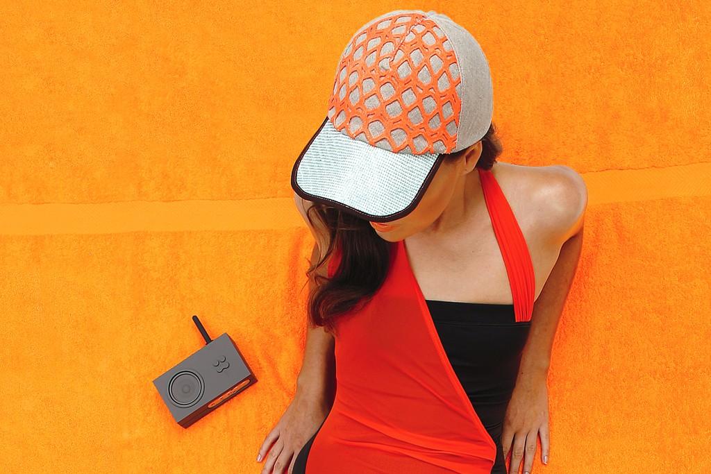 Zero + Maria Cornejo's nylon and elastane swimsuit worn with Noel Stewart Millinery hat, Michael Michael Kors sandals and Lexon radio