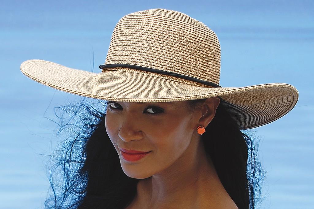 Gottex's polyamide and elastane swimsuit. Scala hat; Kate Spade earrings; Karen London ring.