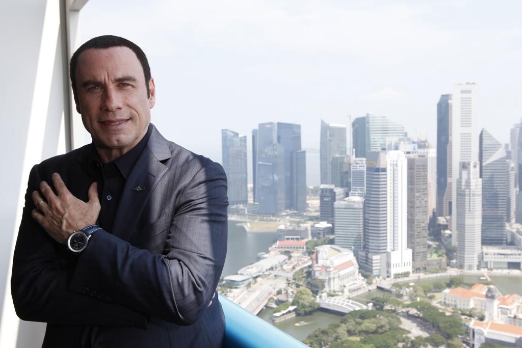 John Travolta promoting Breitling timepieces in Singapore