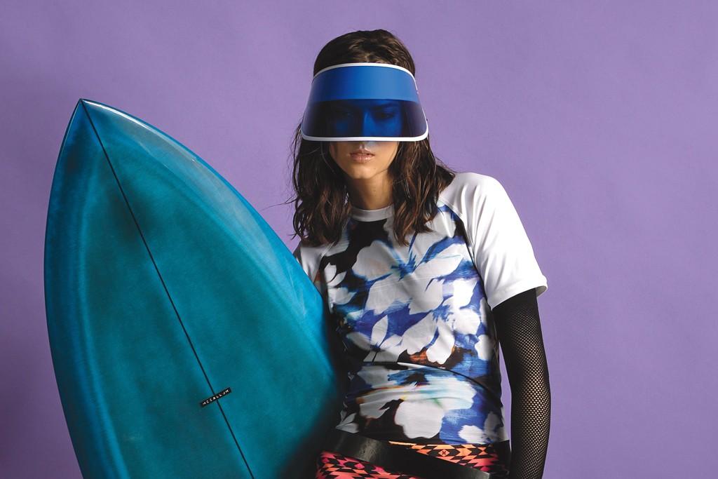 Dakine's Lycra spandex and polyester rash guard; Lip Service's nylon shirt; Hurley's polyester skirt and nylon and Lycra leggings. McCallum surfboard; e4hats visor; Breathe Boardwear belt; Vans shoes.