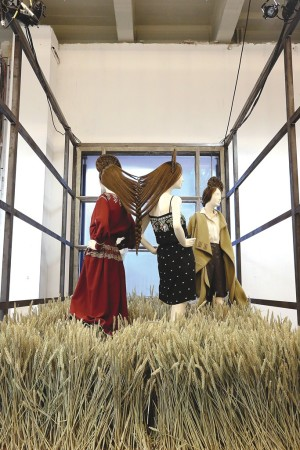 Inspired by a Chloé campaign photographed in a field of wheat, one installation features clothes with nature motifs.