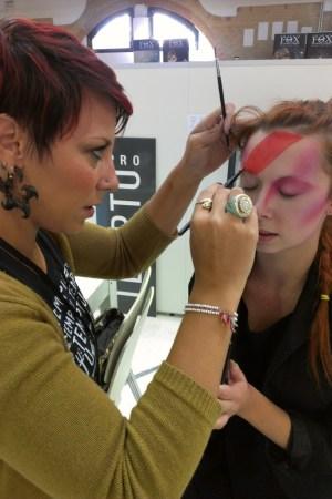 A Temptu makeup artist prepares a model at The Makeup Show Europe.