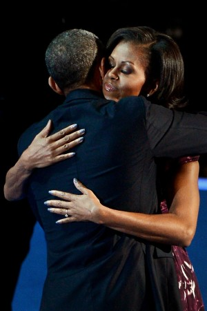First Lady Michelle Obama hugs President Obama before his speech at the Democratic National Convention on Thursday.