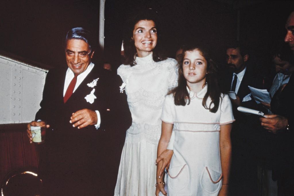 1968: Aristotle Onassis and Caroline Kennedy flank Jacqueline Kennedy in Valentino.