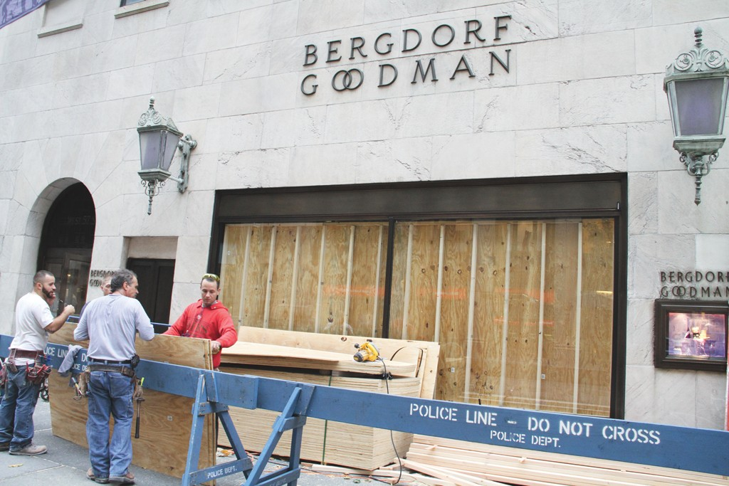 Workers ready Bergdorf Goodman for the hurricane.