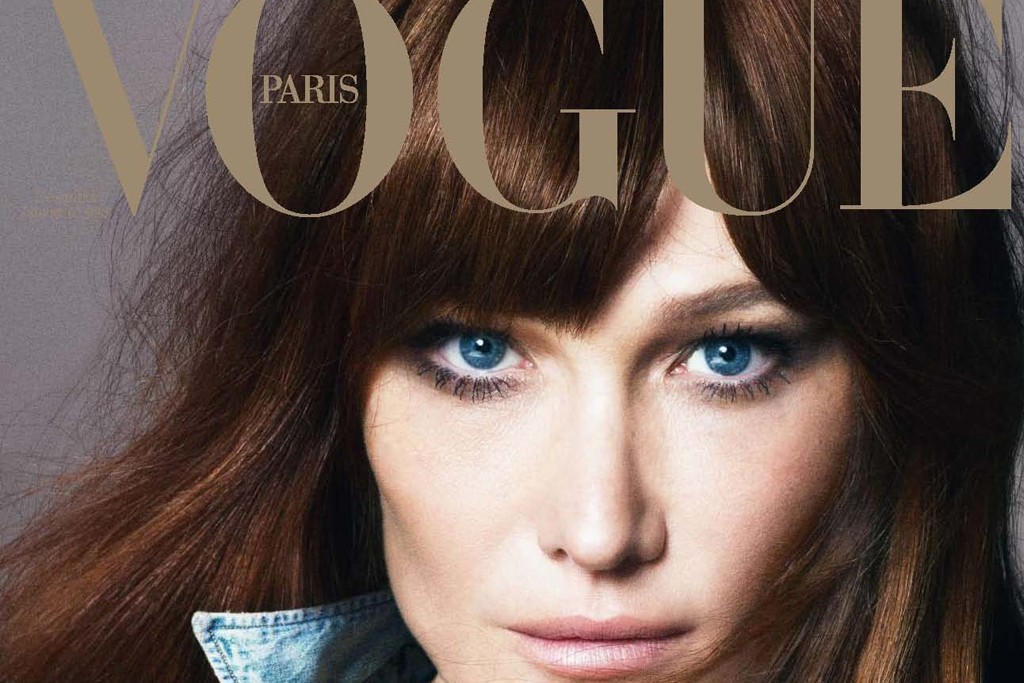 Carla Bruni shot by Mert & Marcus on the cover of the December issue of French Vogue.