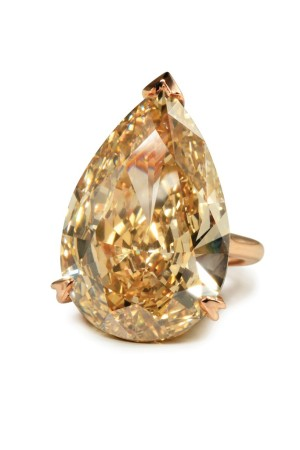 A 29.56-carat yellow brown diamond ring on an 18-karat rose gold mounting.