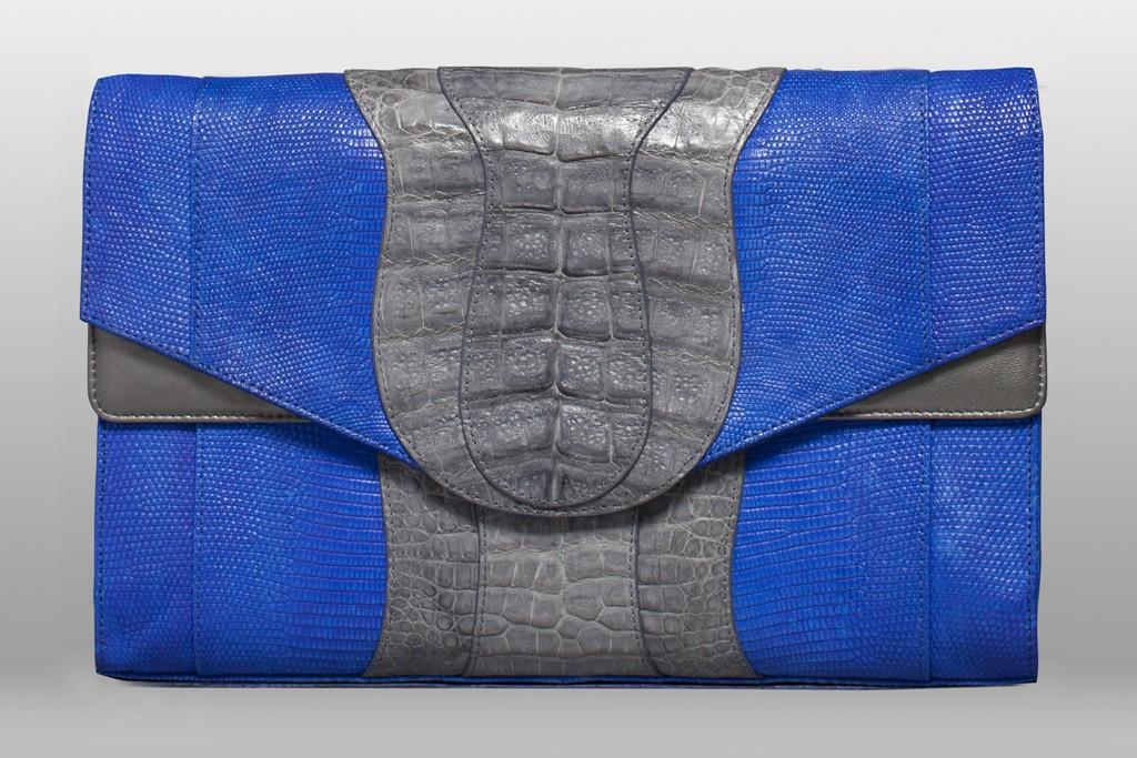 Khirma Eliazov's Herzog clutch in cobalt lizard with grey crocodile.