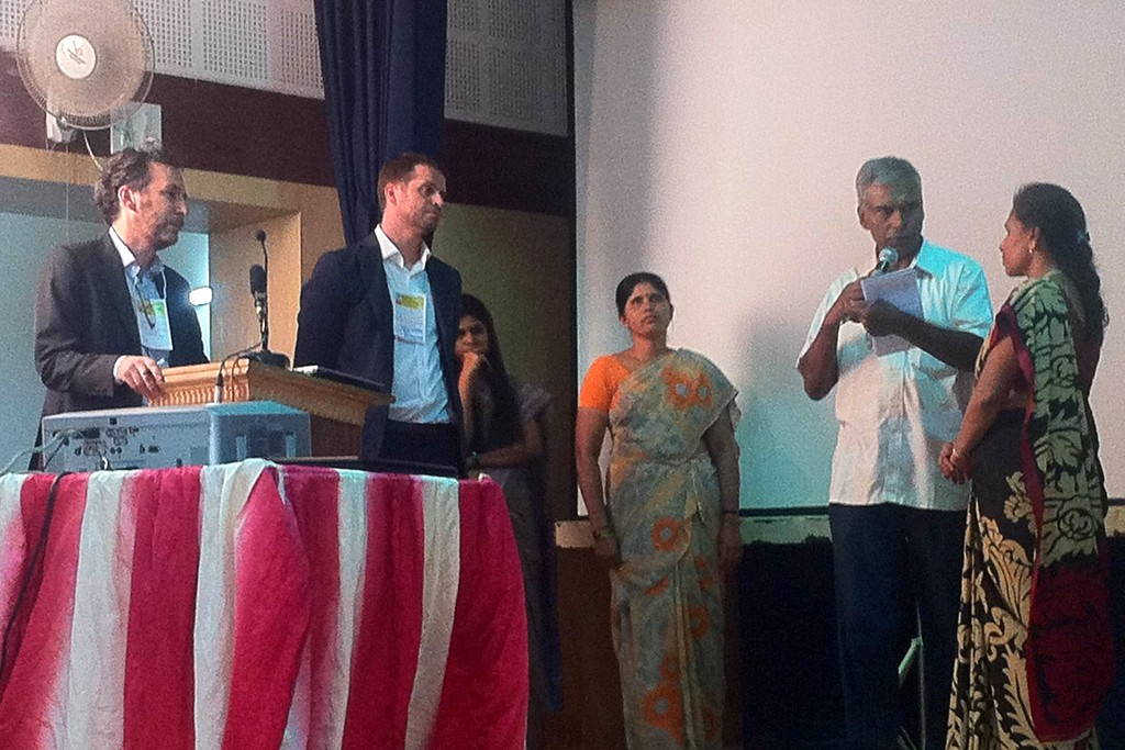 Workers speak at the tribunal in India.