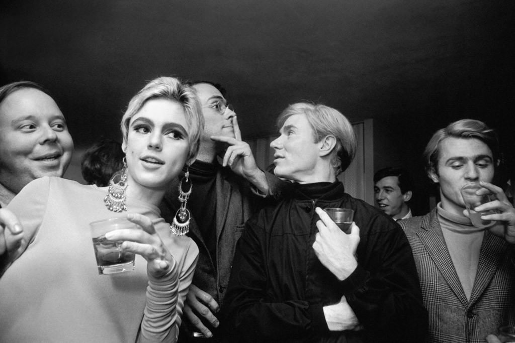 Edie Sedgwick, Andy Warhol, and the Factory crowd.