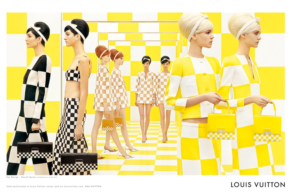 Models wander a checkerboard set by Daniel Buren in Louis Vuitton's spring ad campaign.