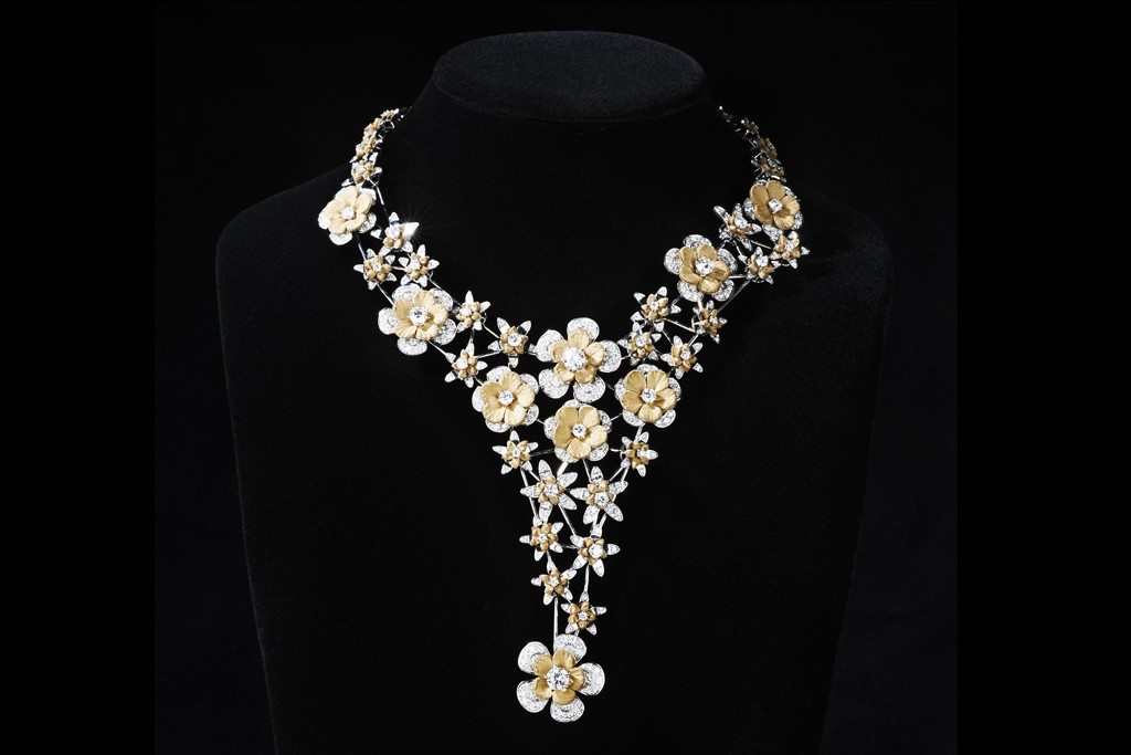 Wilfredo Rosado's leather and diamond flower necklace.