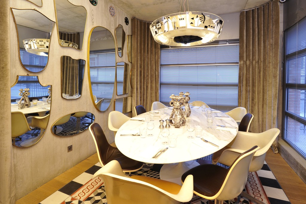 A dining area at Ma Cocotte, designed by Philippe Starck.