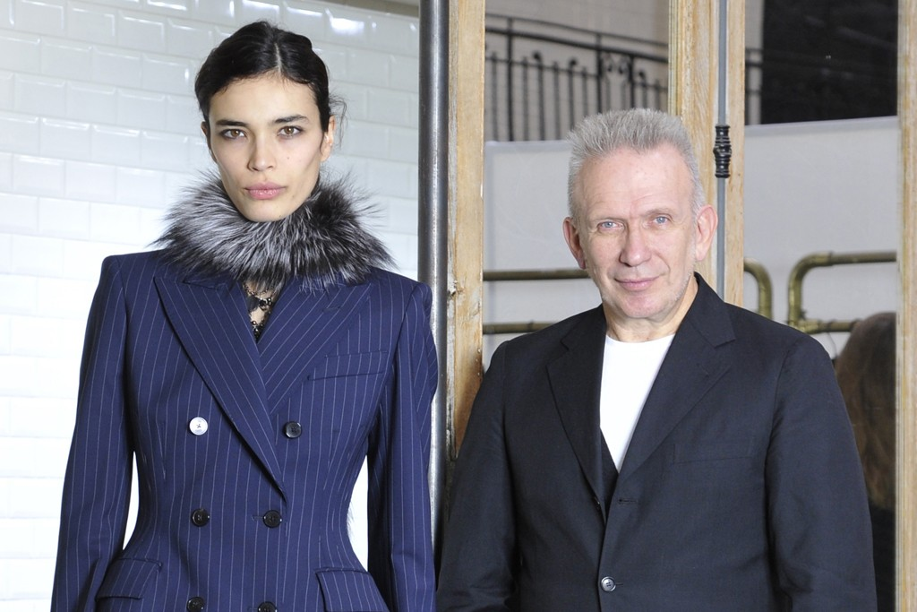 Jean Paul Gaultier with a model in one of his pre-fall '13 looks.